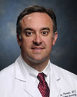 John B. Fiveash, MD